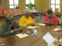 photo of seniors doing arts & crafts at the library