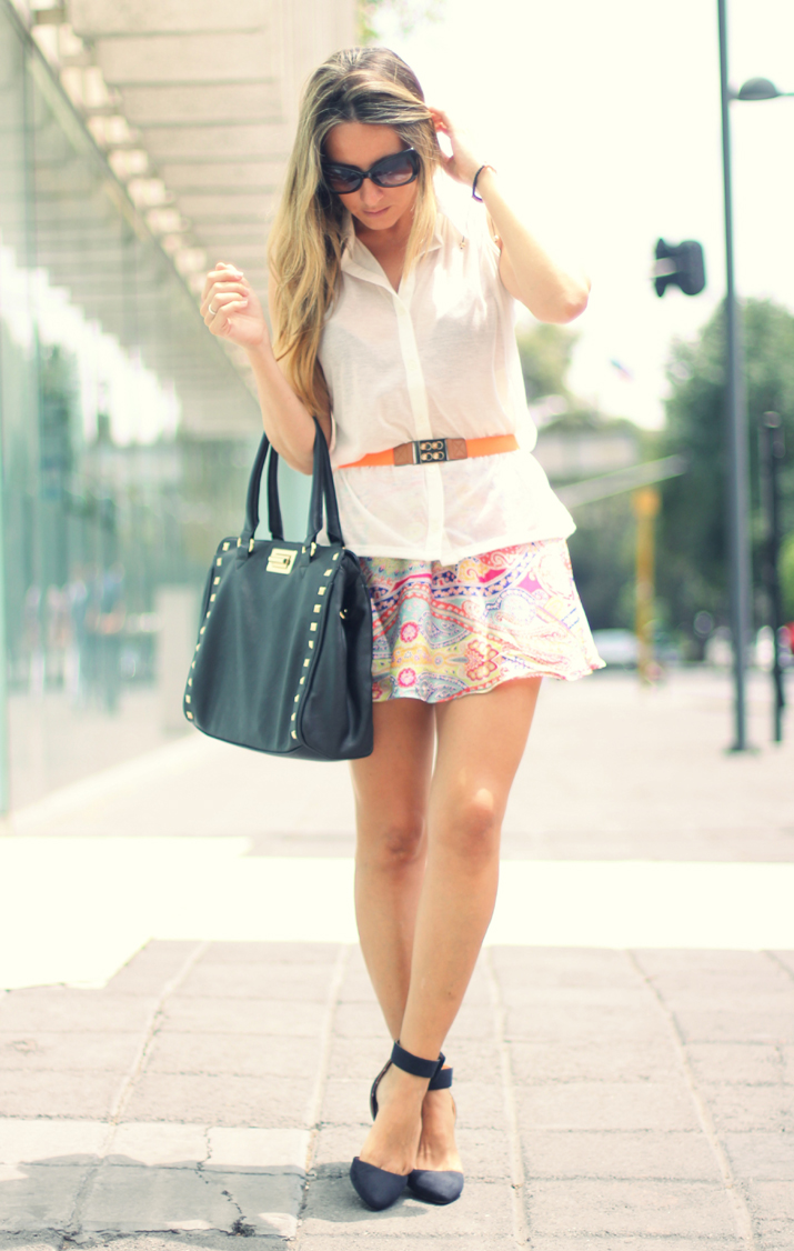 Fashion blogger outfit with scarf printed skirt and studded bag