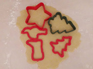 Christmas cookie cutters pressed into dough