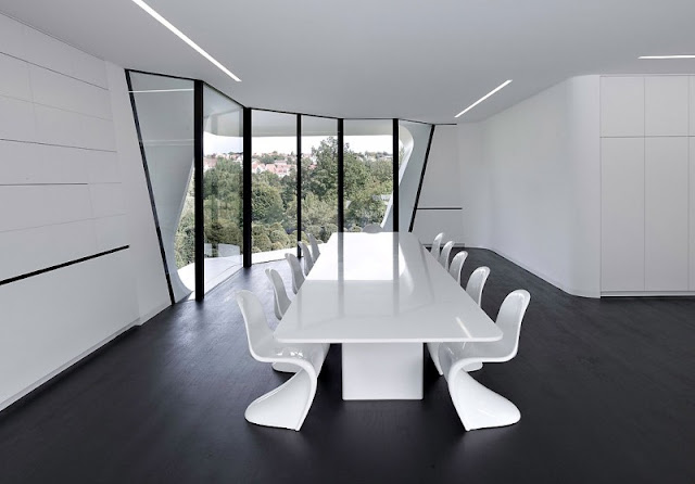 White Colored Marble Floor and Square Shaped Table Made from Shiny Wooden Material