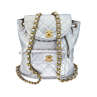 Vintage 1990's silver Chanel mini backpack with gold hardware and gold CC closure.