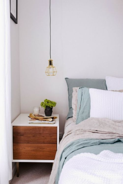 simple white grey and blue bedroom with brown bedside cabinet
