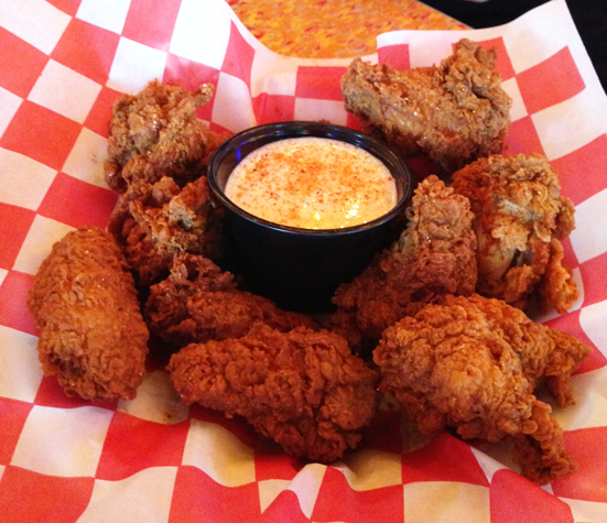 As The Wings Arrived I Noticed A Few Things They Were Breaded Very Heavily There Were About Ten They Were Served With A Creamy Sauce