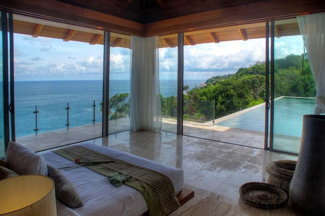 Corner bedroom with ocean view and swimming pool