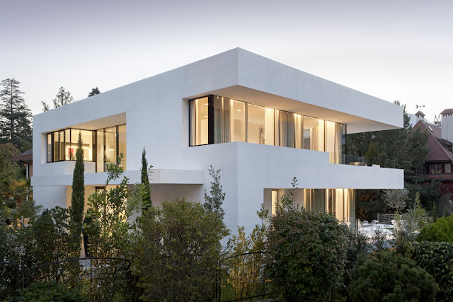 Modern white dream home surrounded by vegetation