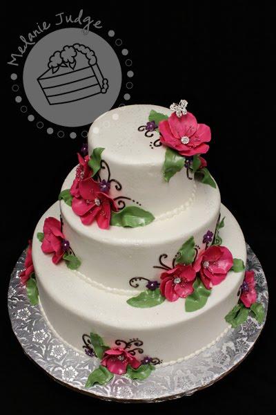 buttercream wedding cake gum paste flowers with rhinestones pink purple