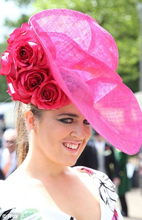stunning oversized hot pink hat with roses on day two of Royal Ascot 2014