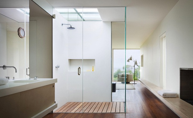 Photo of shower cabin with glass walls inside of modern small home