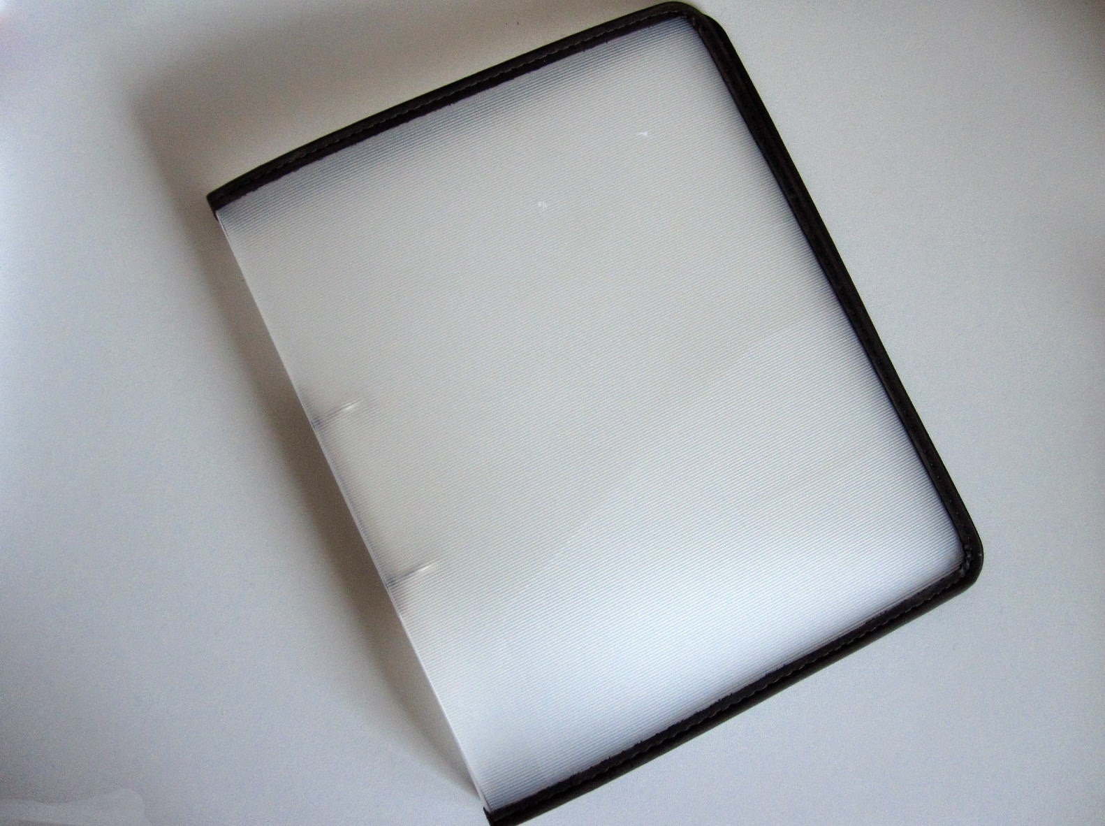 Opaque plastic ring binder.
