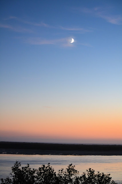 Photo of the moon over Netarts Bay Oregon by Nancy Zavada