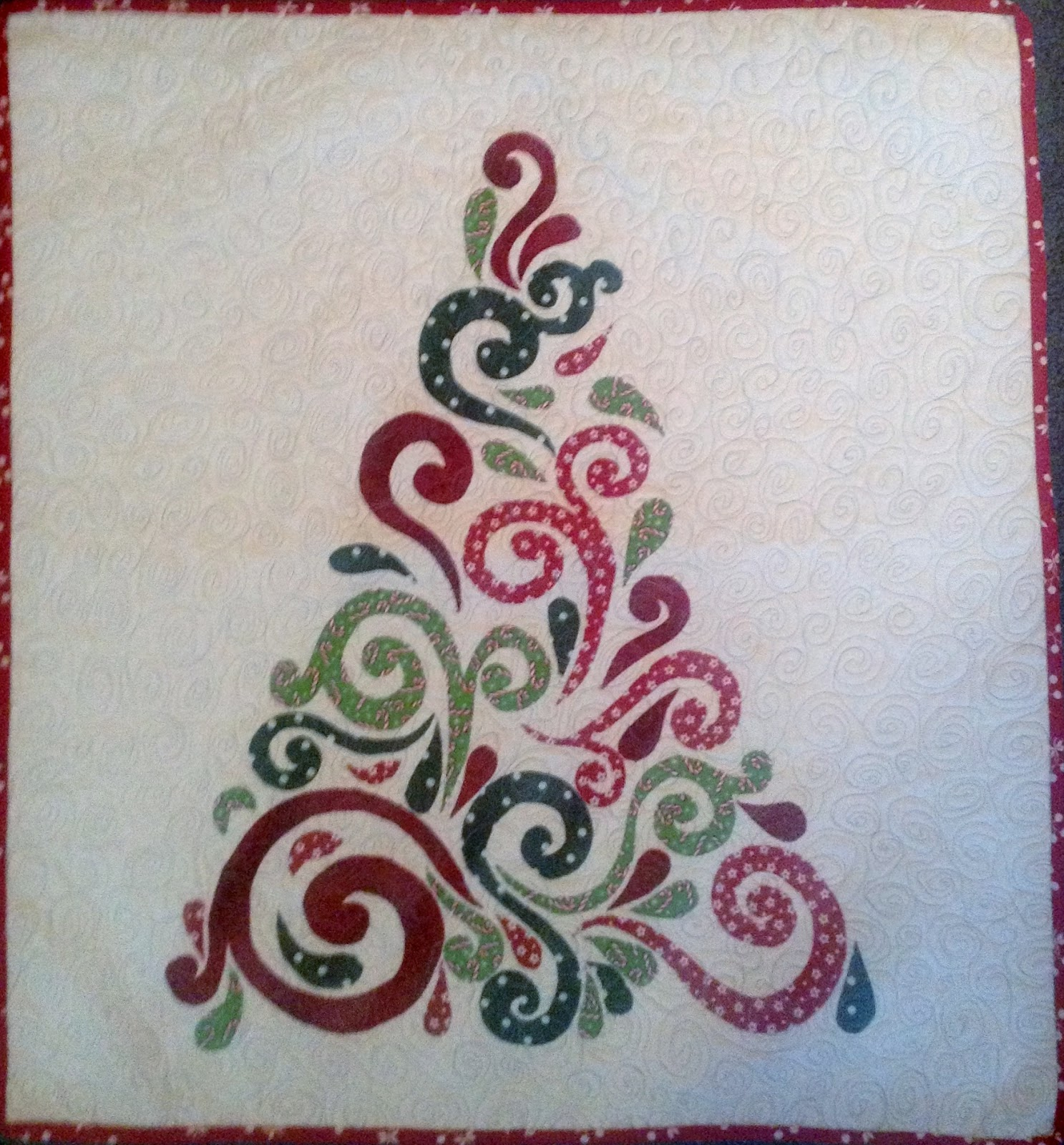 Saw this Swirly Christmas tree wallhanging on Craftsy