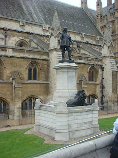 A statue of Oliver Cromwell in front of Westminsters Abbey, London, England