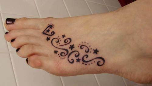 Beautiful curves and stars tattoo on feet