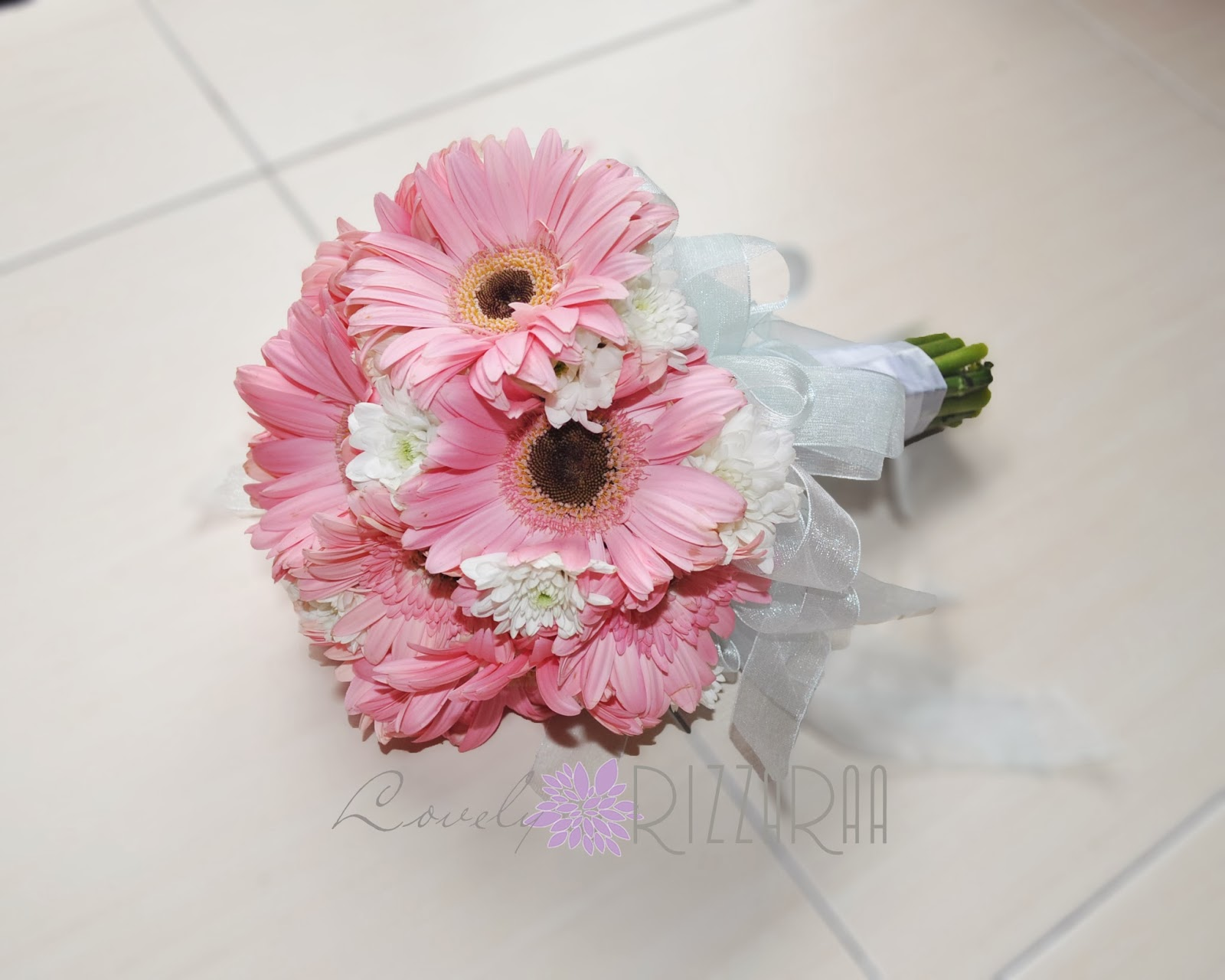 Lovely rizzaraa hand tied bridal bouquet pretty gerberas a cute hand bouquet for fazs engagement made from fresh flowers gerberas in coral and a little pinch white chrysanthemum to enlighten the colors izmirmasajfo