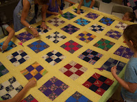 learning to sew a quilt on a frame