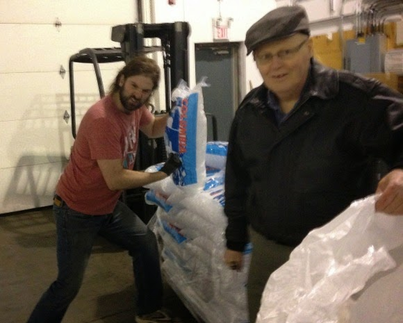 image of the Iceman punching bags of ice to make crushed ice.