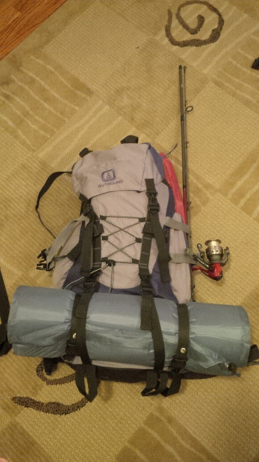 Securing tent poles and fishing rod to my pack