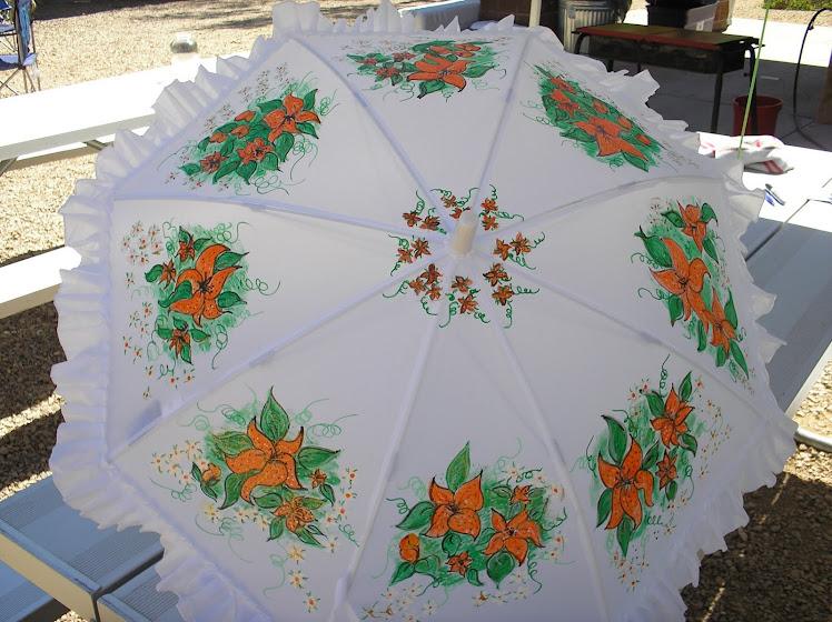 white parasol with orange lillies