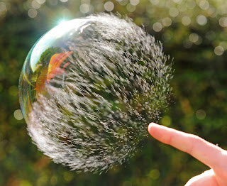 Bursting bubble - an analogy to the early universe.