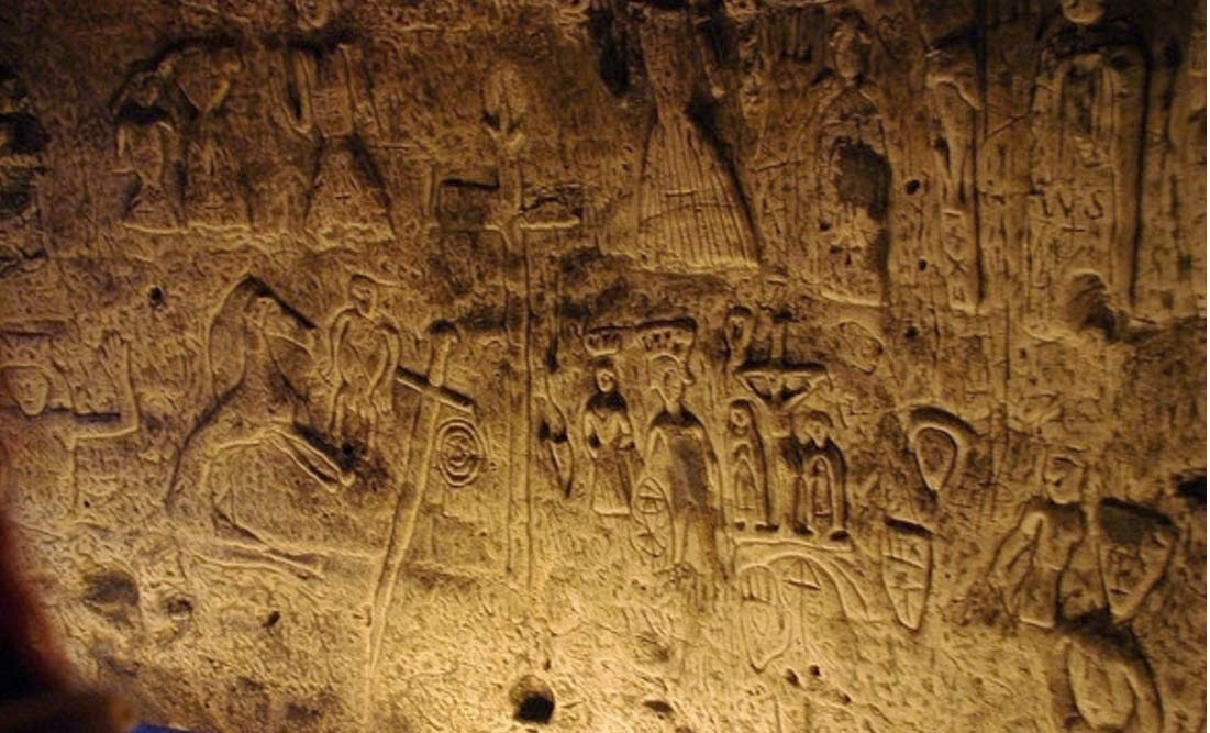 Ufo mania enigmatic symbols and carvings in man made cave