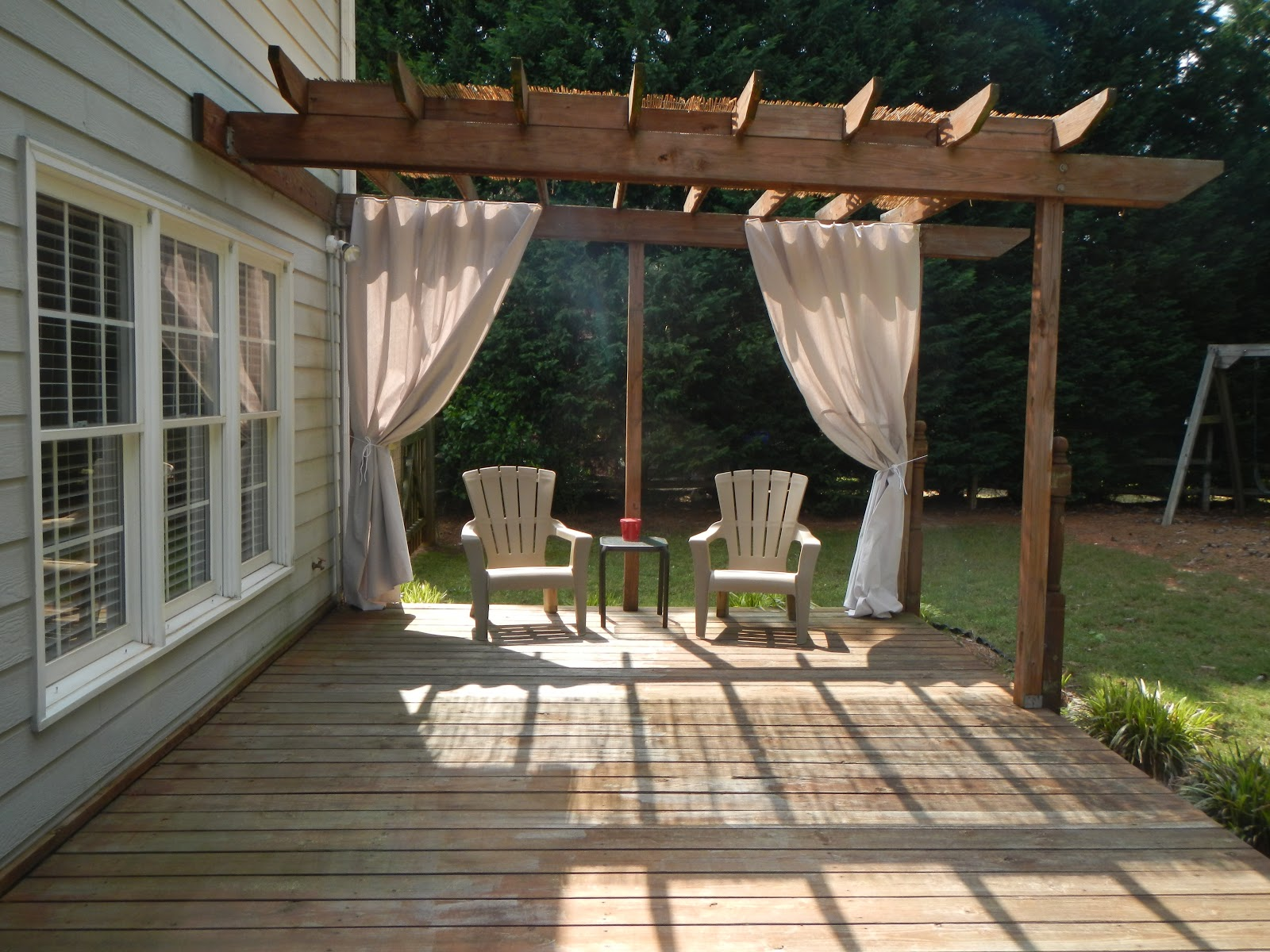 added a bamboo reed screen for the top of the pergola to give a ...