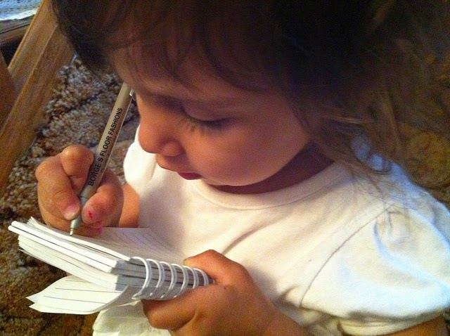 adorable little girl writing