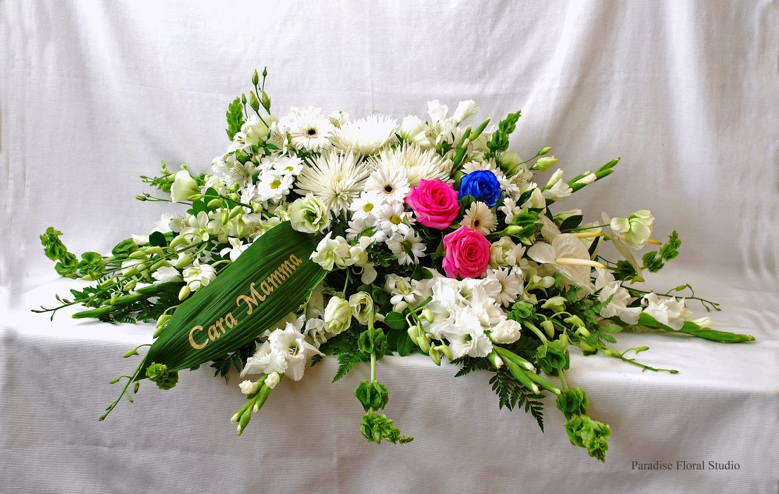Paradise floral studio funeralsympathy sympathy flowers can vary from traditional shapes to vase arrangements to potted plants below are a few traditional shapes click image to enlarge and view izmirmasajfo