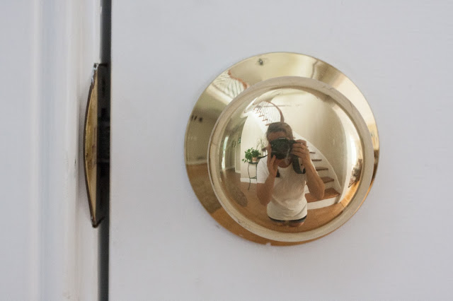 photographer reflected in a doorknob
