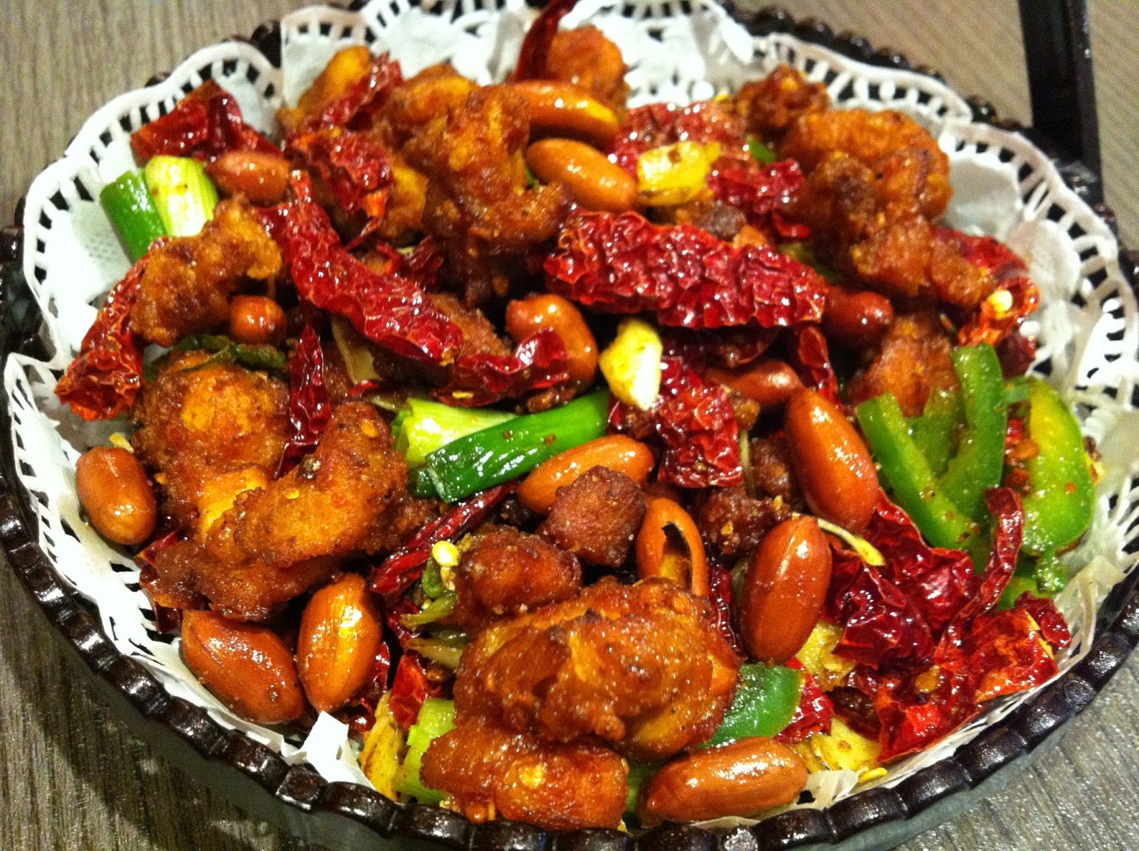 Cubes - the chicken cubes are stir fried with dried chilli, green ...