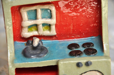 ceramic model of play kitchen