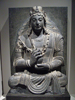 Bodhisattva Maitreya. Just as Gautama Buddha passed through over five hundred lives as a Bodhisattva lone who is irrevocably on the path to becoming a Buddha), so the next Buddha, Maitreya, who will be born five thousand years after the passing of Gautama, already exists as a Bodhisattva and was present when Gautama first turned the Wheel of the Law. Nepalese bronze, thirteenth century. Victoria and Albert Museum, London.