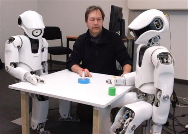 Luc Steels with Myon Robots