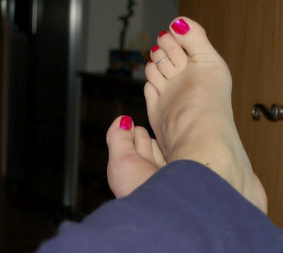 man wearing pink nail polish and toe ring