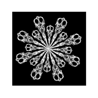 starburst of white vintage scissors on black
