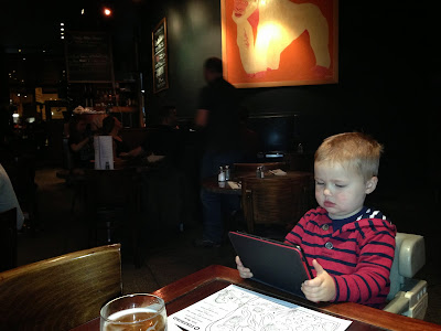 Occupied with a Kindle at a restaurant