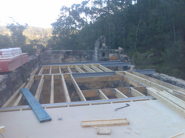 starting the floor joists and steel beams