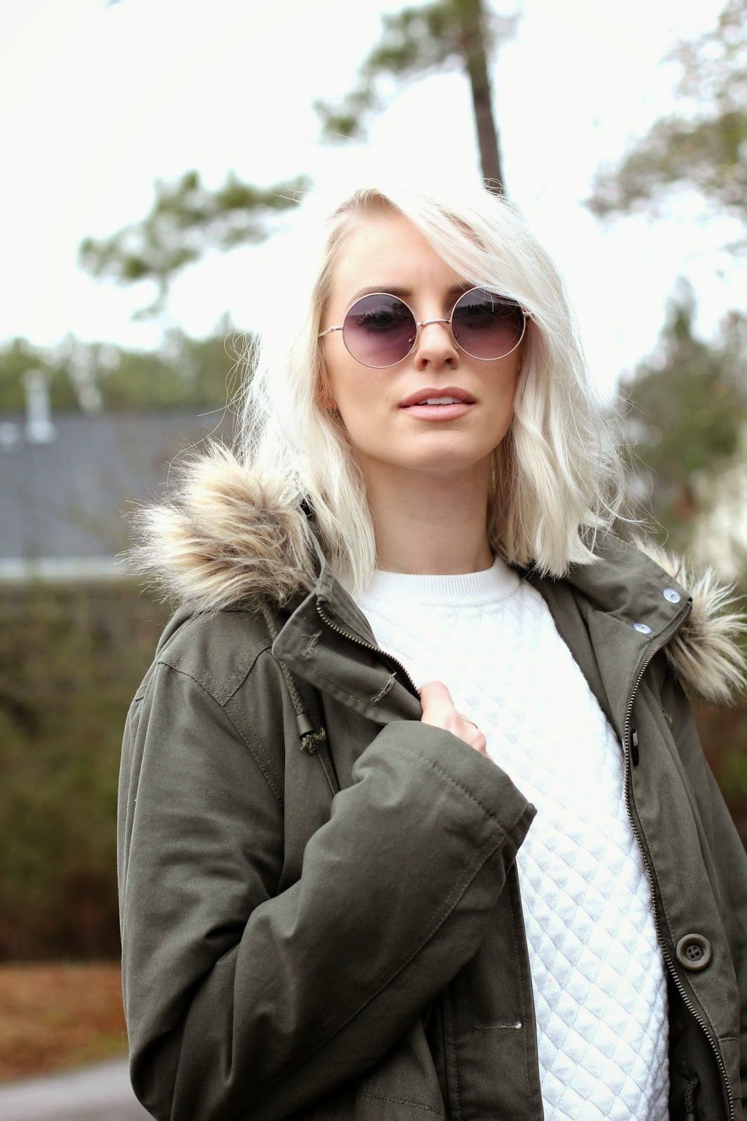 olive green parka with brown fur hood tobi boutique cream white quilted sweater top denim boyfriend jeans target cuffed brown combat military boots jacket platinum blonde hair short long bob tousled round glasses elton john lennon woods mountain wear cold weather charleston sc blogger street style fashion like the yogurt dannon k collard