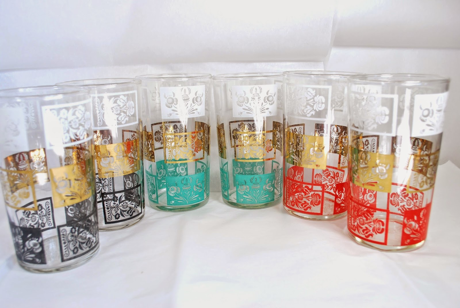 https://www.etsy.com/ca/listing/214933283/barware-set-of-6-tumblers-gold-and?ref=shop_home_active_5
