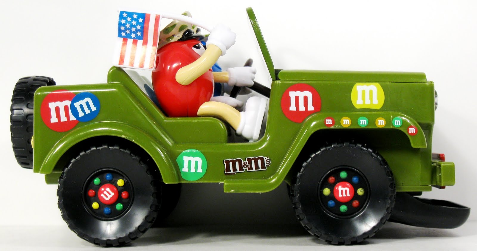 Toys And Stuff Candyrific Mms Military Vehicle Dispenser Hotwheels Vw Drag Bus Mnm Rare Yet Again The Jeep Is Peppered With Graphics Even Hubcaps Are Designed To Resemble Its A Fun About As Cartoony Toy