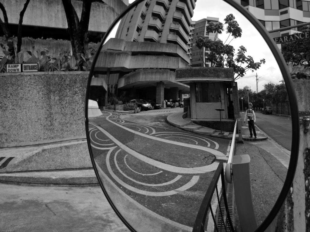 Despite having all the permits to shoot the security officers still are very suspicious as I am doing my street photography in this part of Makati. (Photo by Bernard Eirrol Tugade)