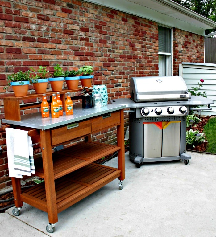 outdoor plant cart also functions as an outdoor bar cart