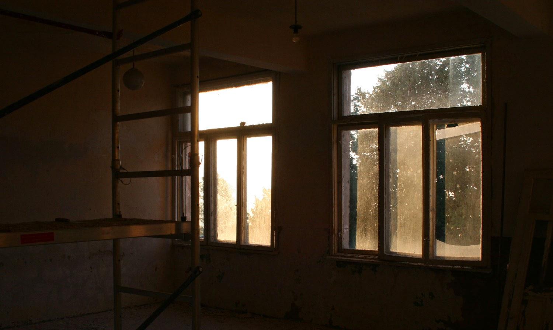 Morning sun through store room windows