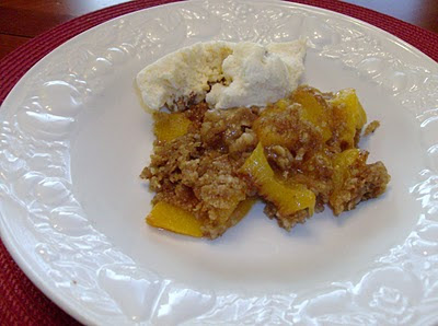 Slow Cooker Peach Crisp Recipe from 365 Days of Slow Cooking featured on SlowCookerFromScratch.com