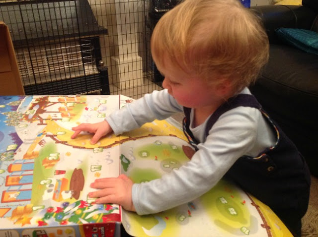 picture of a toddler looking at the advent calendar