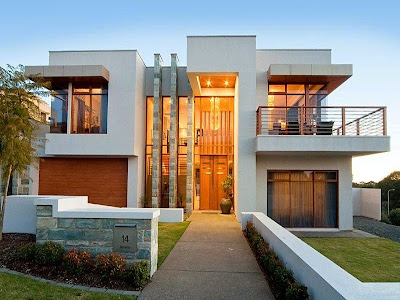 Concrete modern house exterior with balcony and feature lighting