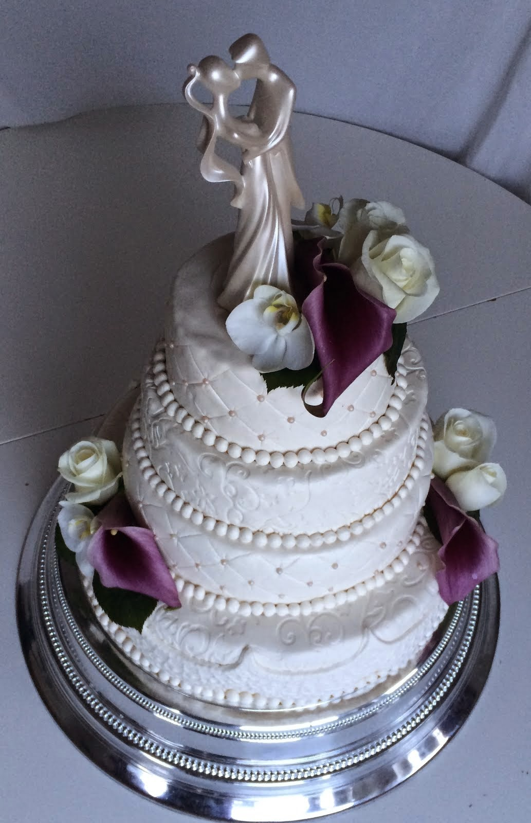 Bröllopstårta med kallor,rosor & orkidéer