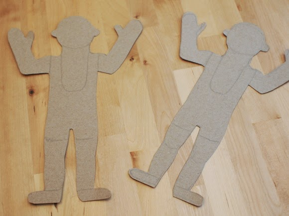 Cut out climbing men from cardboard