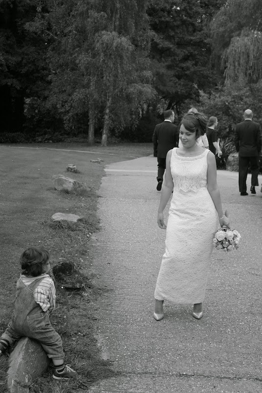 Real bride Clare on path outside wedding