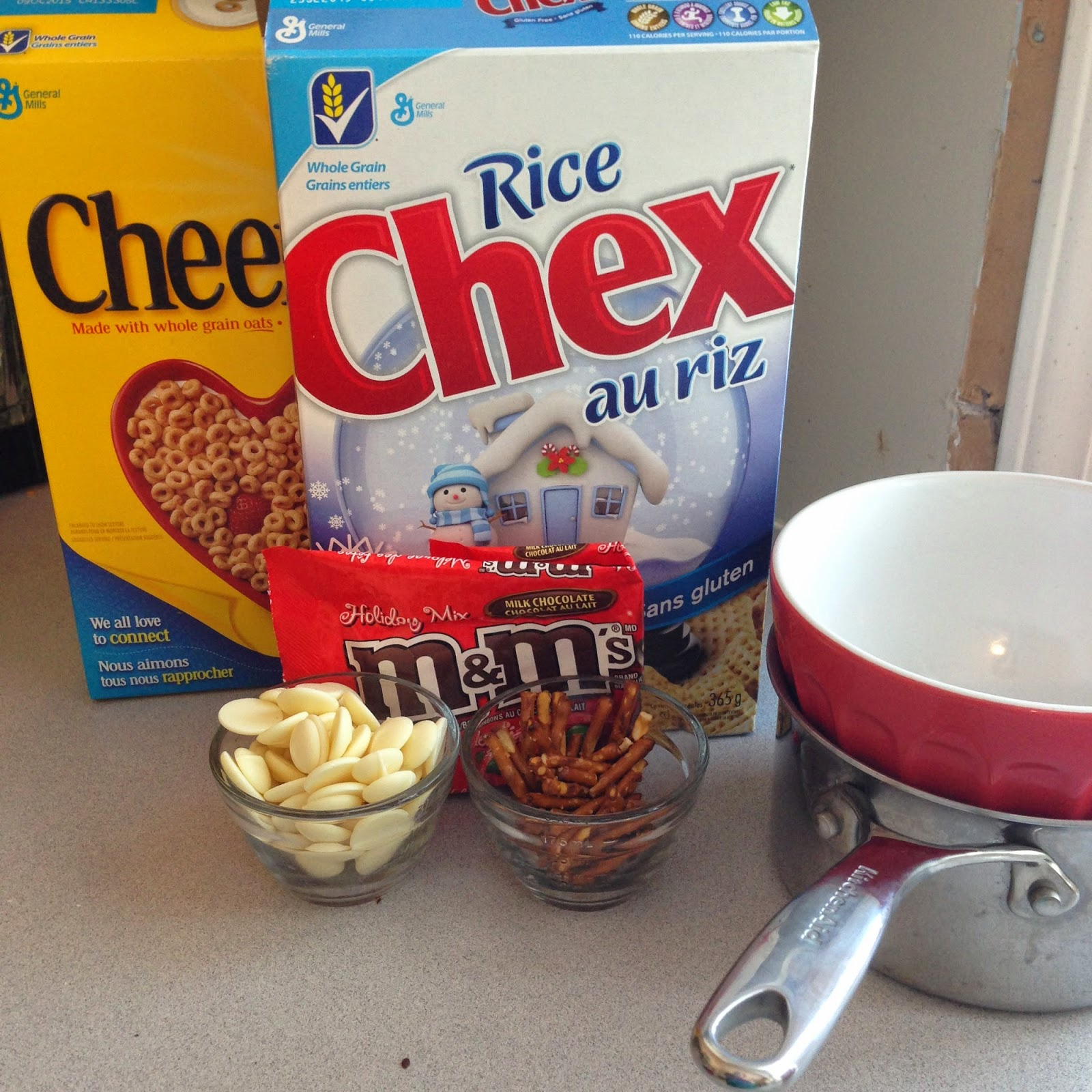 Small Pot And Glass Bowl Or Double Boiler Pretzel Sticks White Chocolate Melts Christmas Mms Cheerios And Chex Cereal