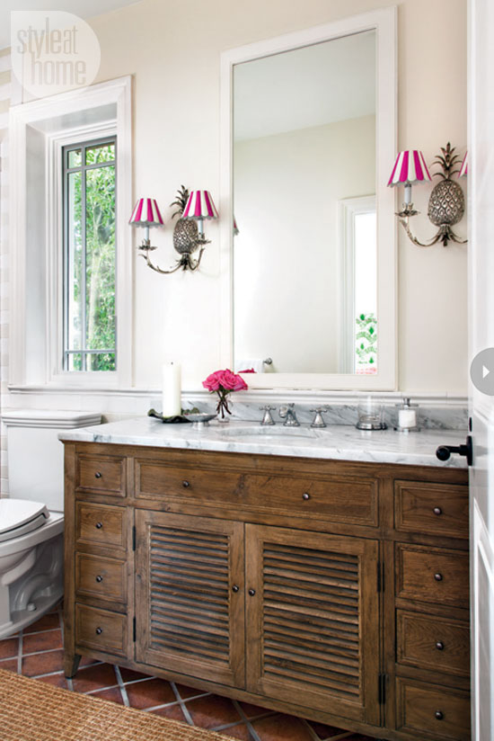 Pineapple Sconces With Scalloped Candy Striped Shades In The Bathroom Reference Vibrant Preppy Personality Of Rest Guest House